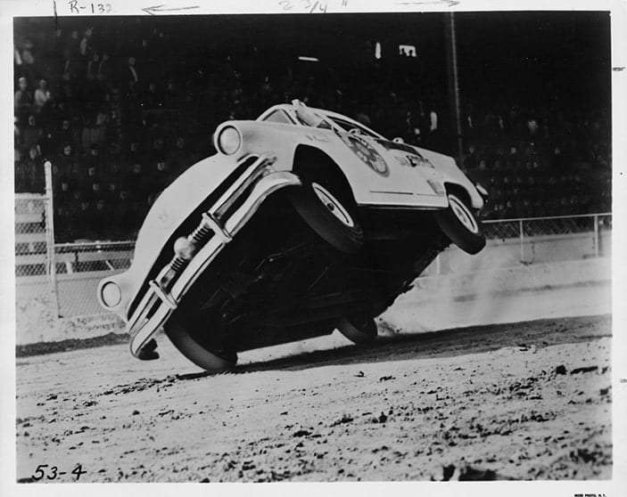 A black and white photo, from Missouri State Archives, of a car tipped sideways, driving on two wheels