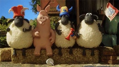A still from a giphy gif of an Aardman animation showing a surprised pig dropping a cup