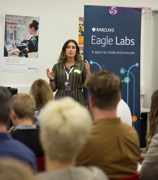 Barclays Eagle Labs' Katie address the audience at Optimisey, telling them about the venue