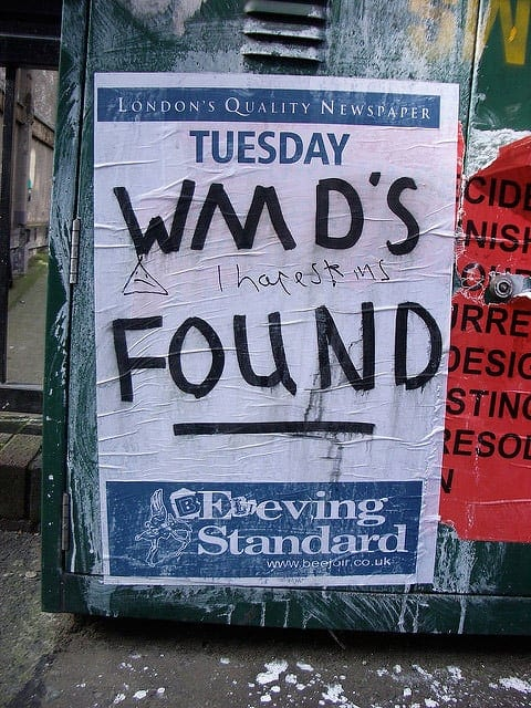 "A photo of a graffiti'd Evening Standard headline poster saying ""WMDs FOUND"""