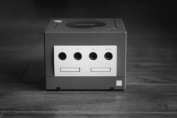A black and white photo by Pawel Durczok, of a games console box with four port sockets