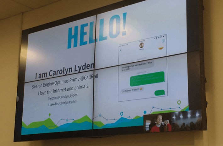 A photo of Carolyn Lyden's opening slide in her SEO Voice Search 101 talk at Optimisey