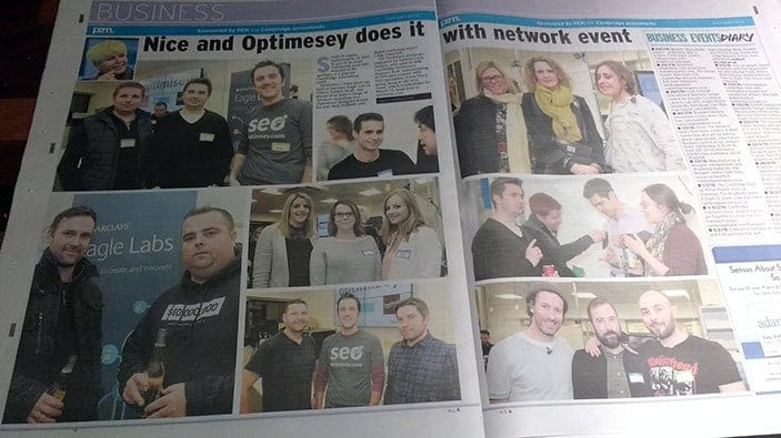 A photo of a double-page spread in the Cambridge News about the Optimisey events