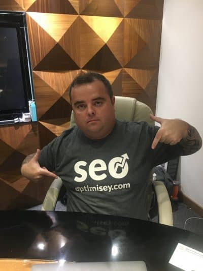 Craig Campbell wearing an Optimisey.com t-shirt