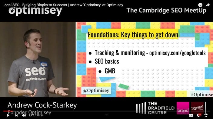 A screenshot of a video of Andrew Cock-Starkey talking at the Optimisey SEO event