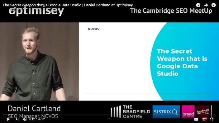 A screenshot of a video of Dan Cartland talking at the Optimisey SEO event