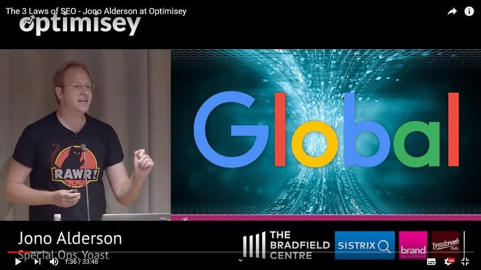 A screenshot of a video of Jono Alderson talking at the Optimisey SEO event