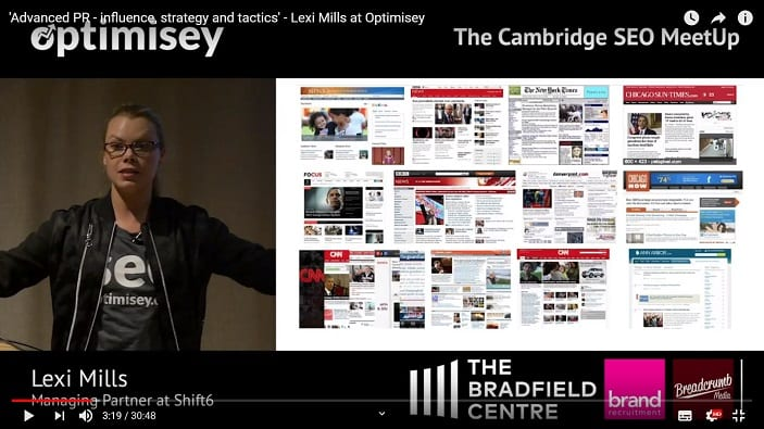 A screenshot of a video of Lexi Mills talking at the Optimisey SEO event