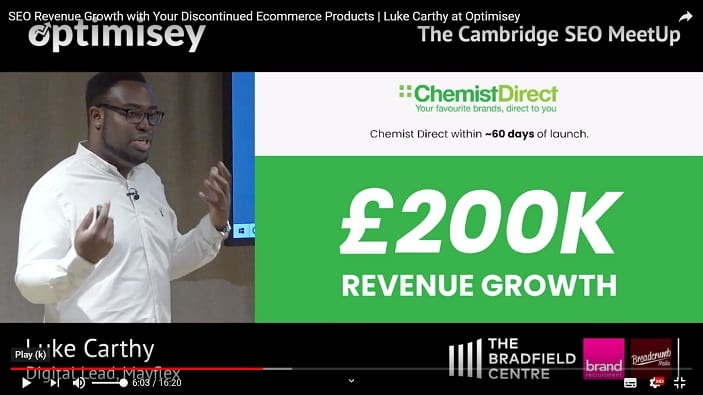 A screenshot of a video of Luke Carthy talking at the Optimisey SEO event