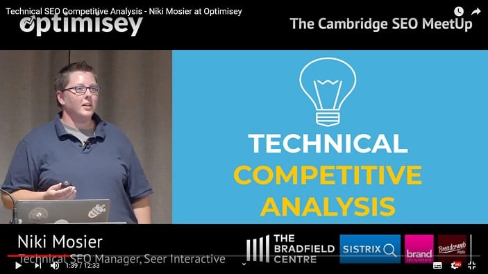 A screenshot of a video of Niki Mosier talking at the Optimisey SEO event