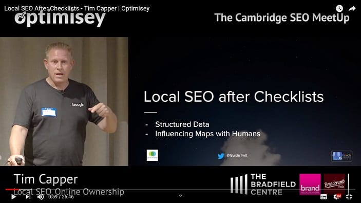 A screenshot of a video of Tim Capper talking at the Optimisey SEO event